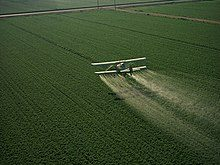 Cropduster spraying pesticides